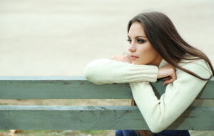 bigstock young lonely woman on bench in 53107465